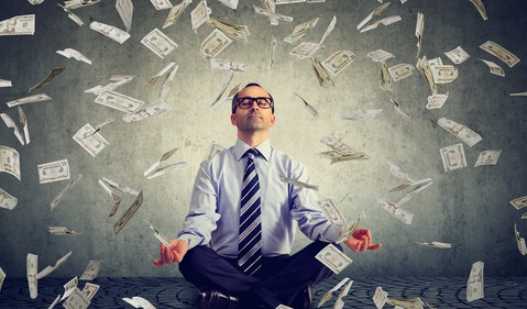 man yoga pose money falling GettyImages-842014930