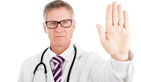 Doctor holding up hand saying stop