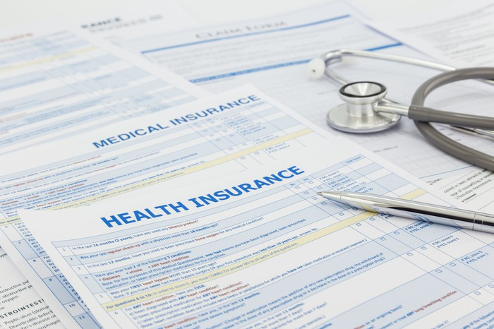 Health insurance papers spread out on a desk