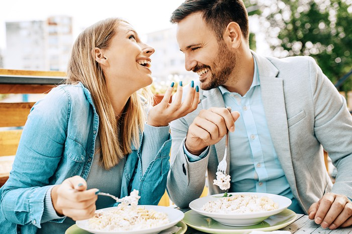 Couple enjoying a nice restaurant meal.