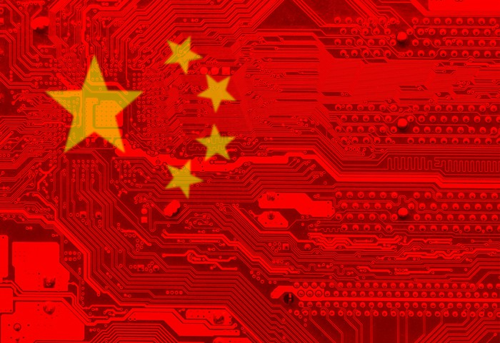 A chinese flag overlaid on a circuit board.