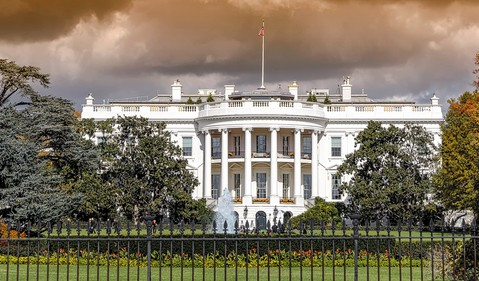 White House with storm clouds