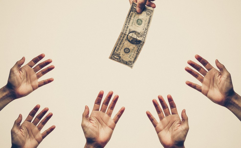 hands reaching for money crop 1500
