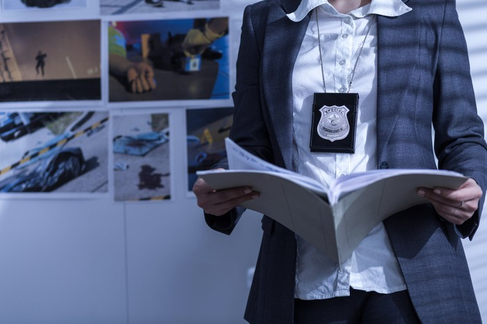 Police woman reviewing files and documents