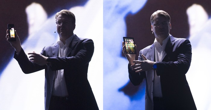 Samsung executive showcasing the new foldable OLED Galaxy X smartphone.