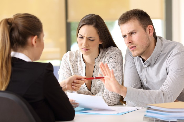 A man and a woman rejecting a mortgage offer.