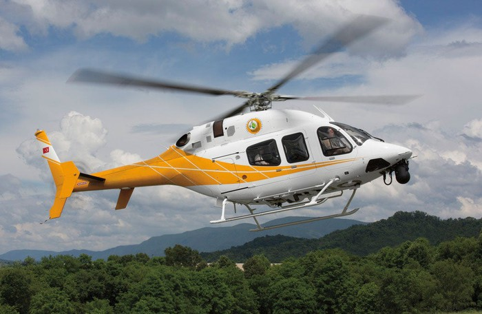 Yellow and white helicopter from Textron's Bell