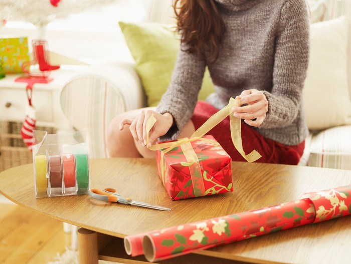 Woman wrapping presents.