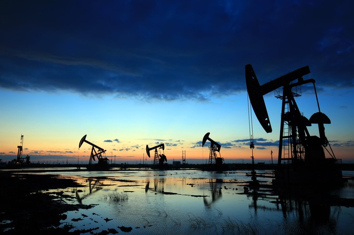 Oil pumps after a storm has passed.