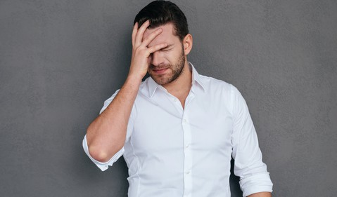 Man in White Shirt Facepalming -- GettyImages-497263458
