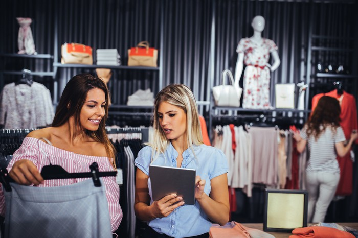 Two women shopping at a clothing retail store