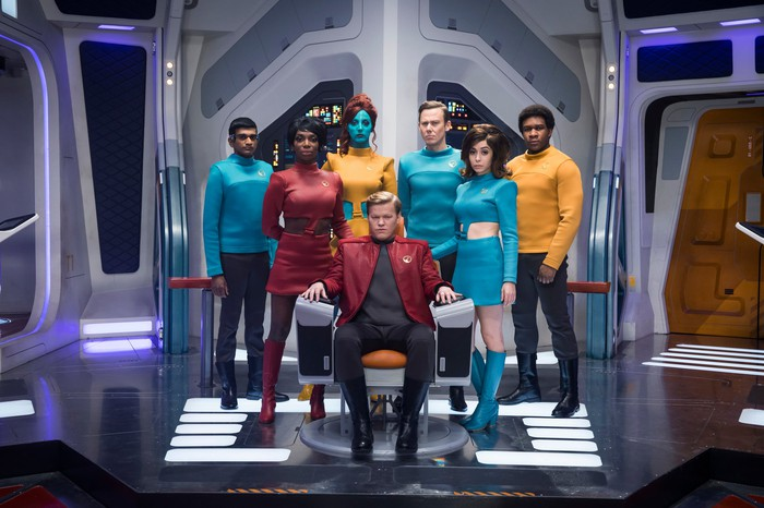 The crew of a star ship assembled on the bridge, with both humans and aliens.