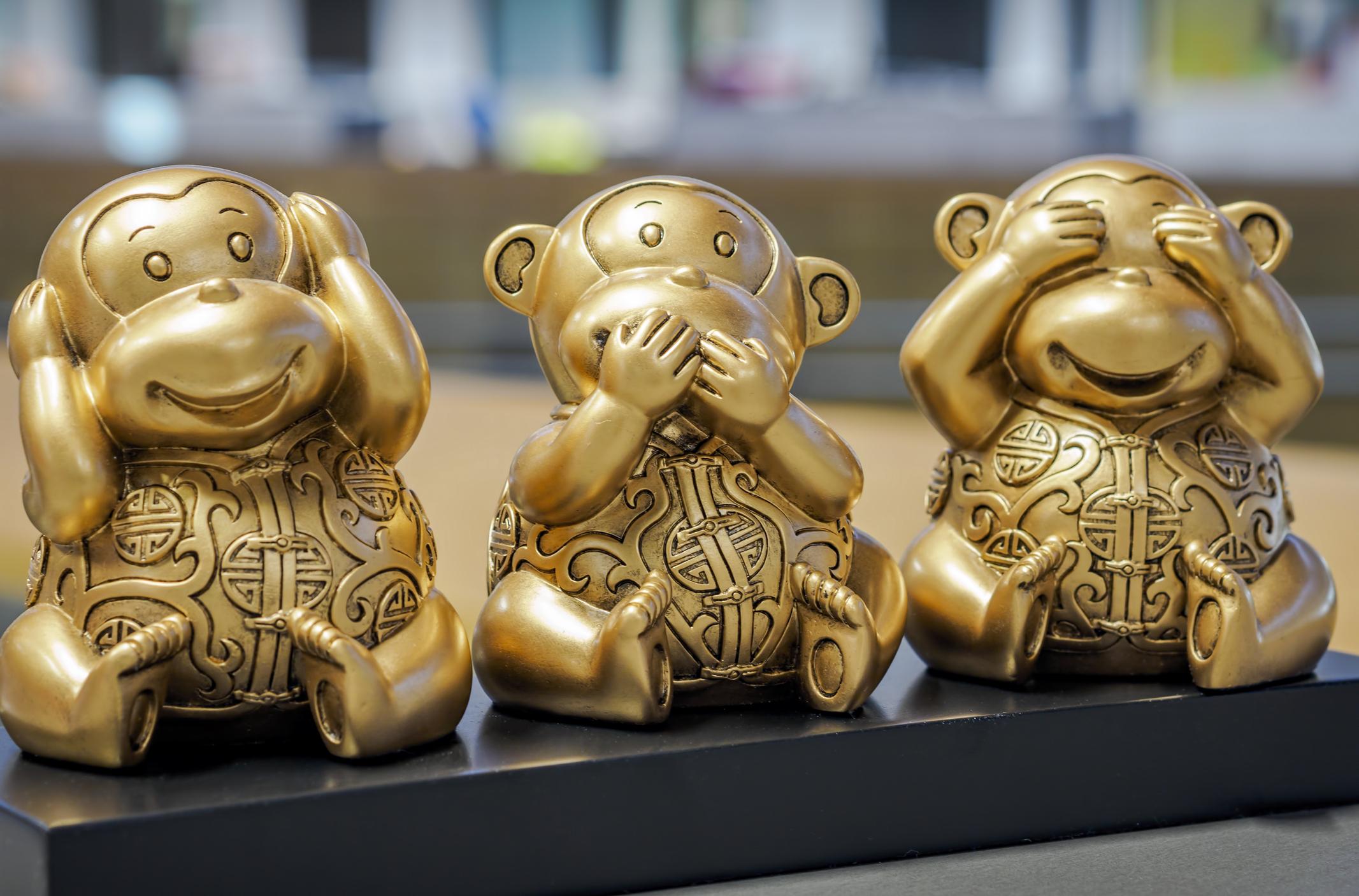 "Brass monkeys depicting ""Hear no evil, speak no evil, see no evil."""