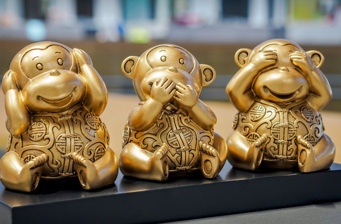 "Brass monkeys depicting ""Hear no evil, speak no evil, see no evil."""