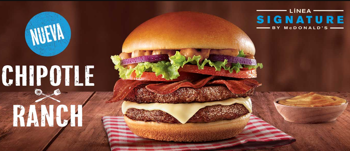 Advertisement showing a hamburger with artisan toppings.