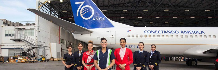 Copa crew standing in front of a Copa airplane