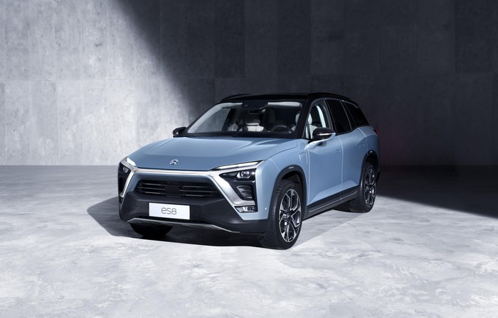 The NIO ES8 SUV in light blue with a black top and black front grille.
