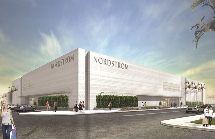 Nordstrom location in white stone with shoppers and cars outside.