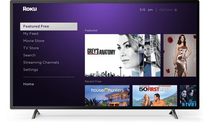 An internet-enabled TV displaying the Roku channel with a number of programs to view.