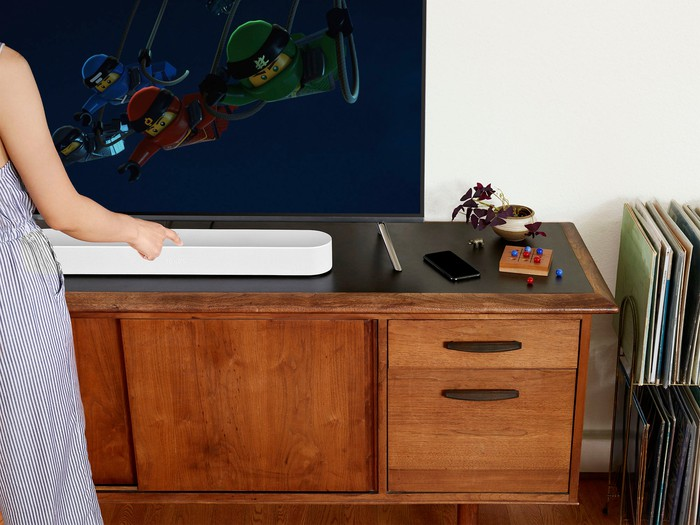 The Sonos Beam in front of a TV.