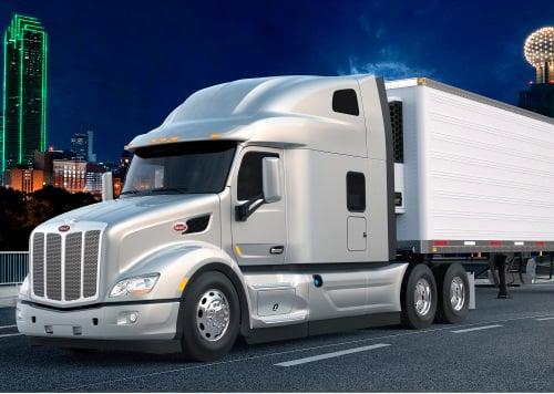 Commercial semi-truck hauling a load.