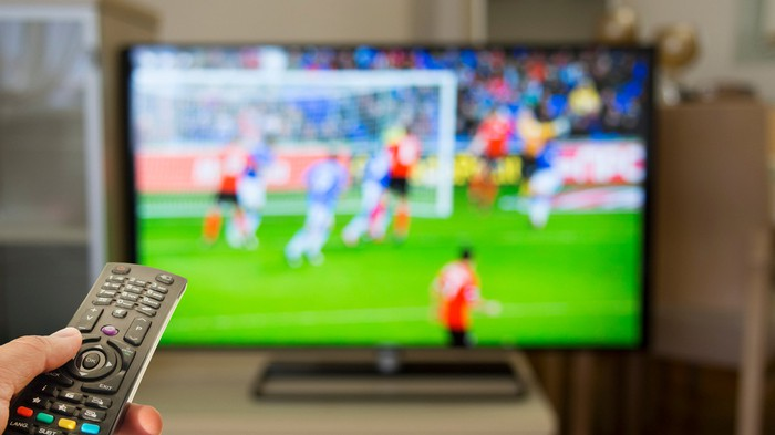 Person watching sports on TV