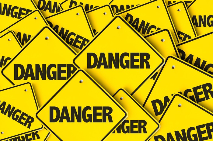 A pile of yellow danger signs