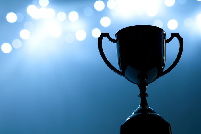 Trophy in the dark with blue abstract background.