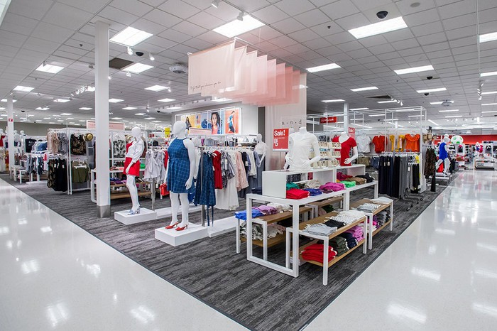 The interior of a Target store, with children's clothing on display.