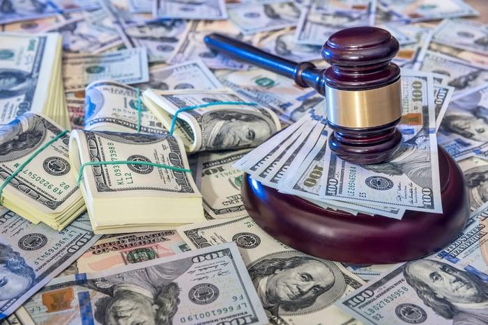 Gavel on stacks of cash