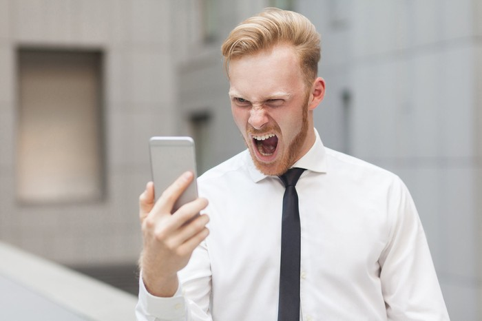 Man yelling at cellphone