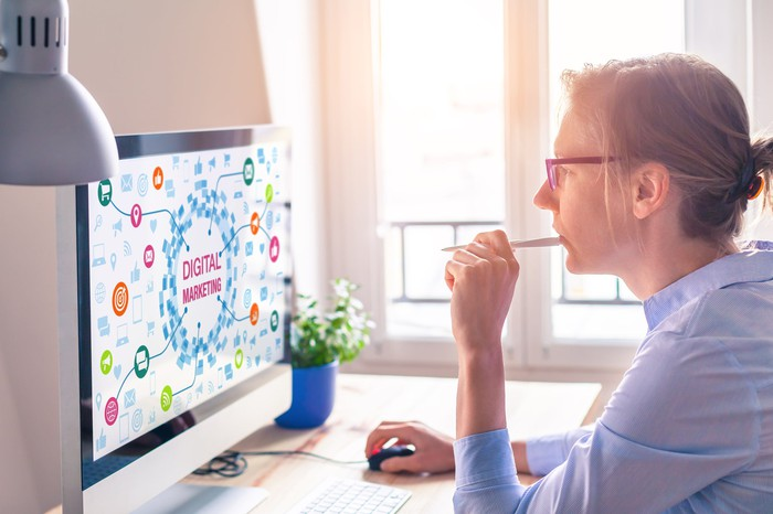 A woman designs a digital marketing campaign.