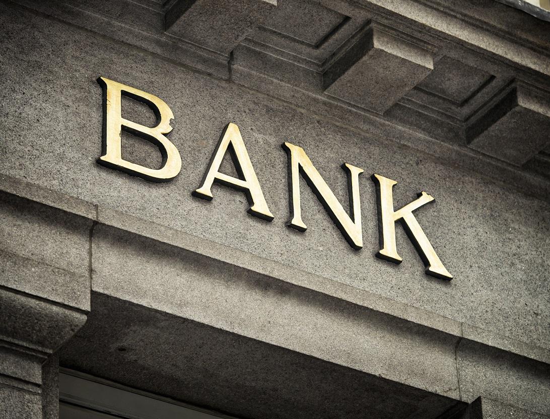 Bank sign on stone facade.