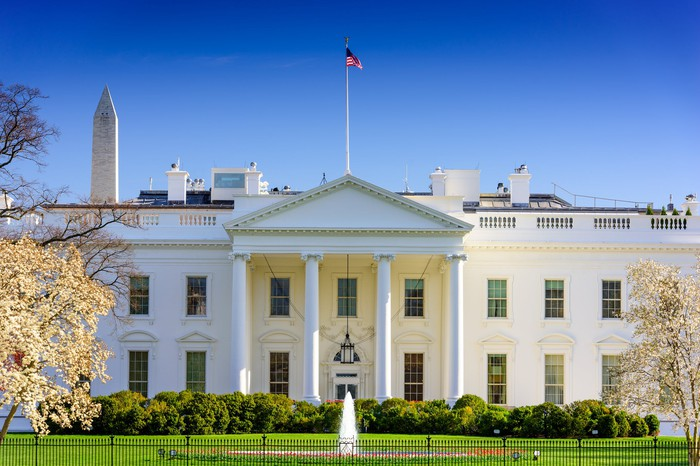 White House from front lawn, with view of Washington Monument in background on a clear day.
