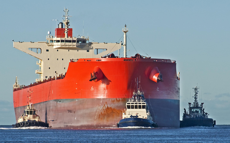 Red dry bulk ship at sea