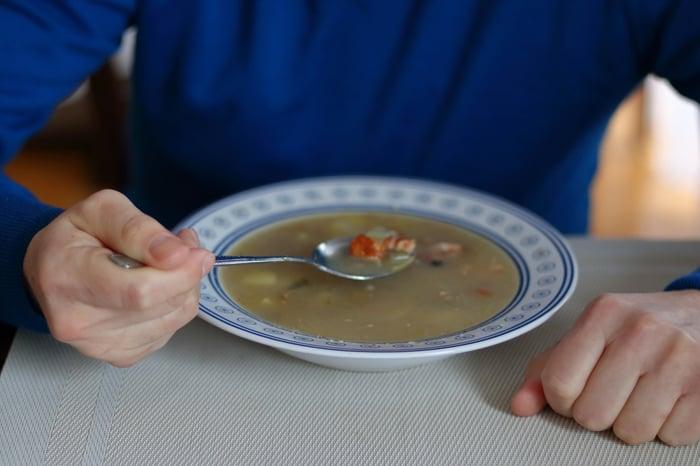Man preparing to eat bowl of soup