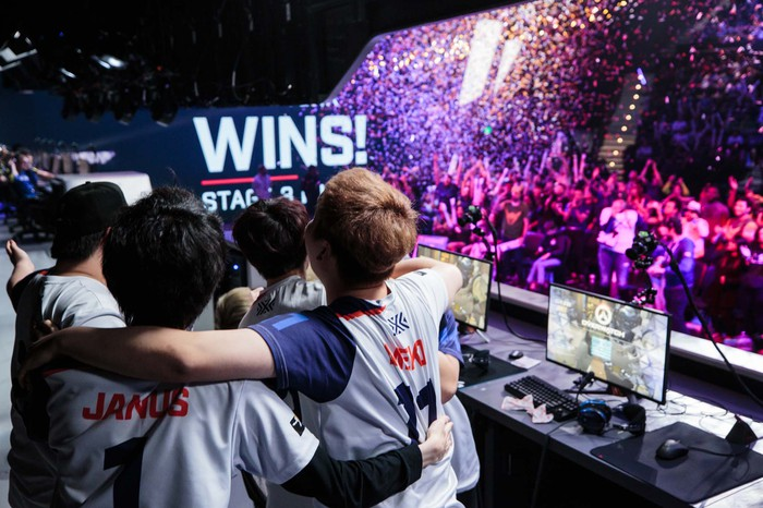 Members of Overwatch League's New York Excelsior team celebrating a win.