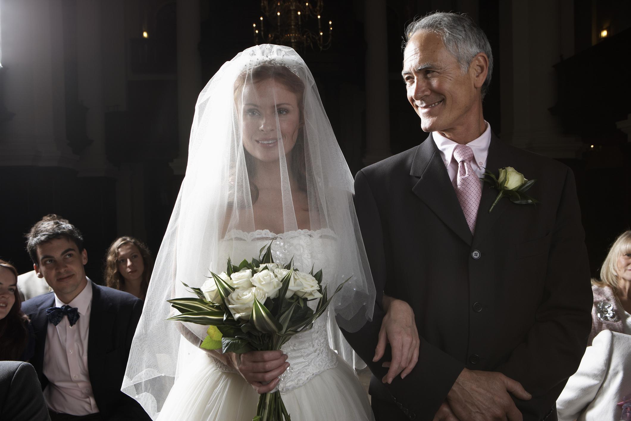 Older man standing next to bride