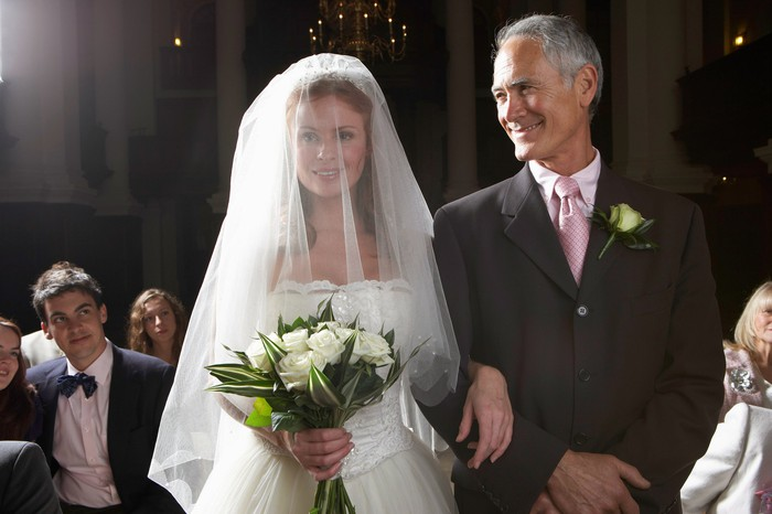 Older man standing next to bride