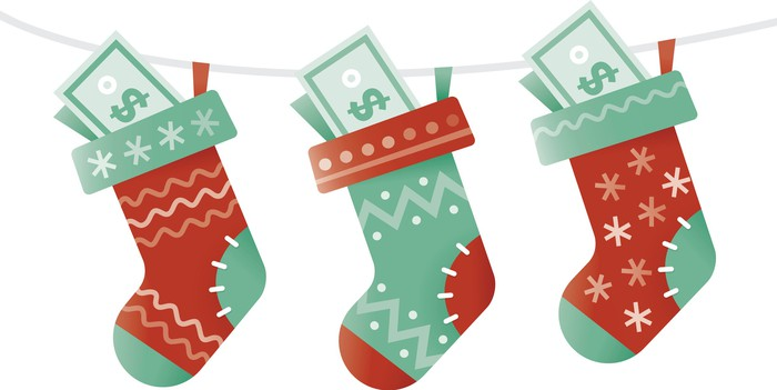 Three stockings with dollar bills in them.