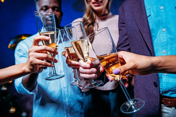 Young professionals holding champagne glasses