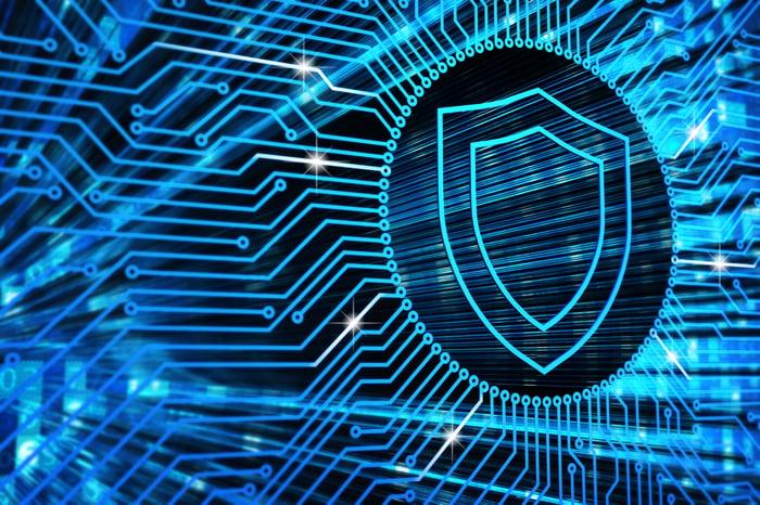 Stylized neon shield logo on an microchip background in blue