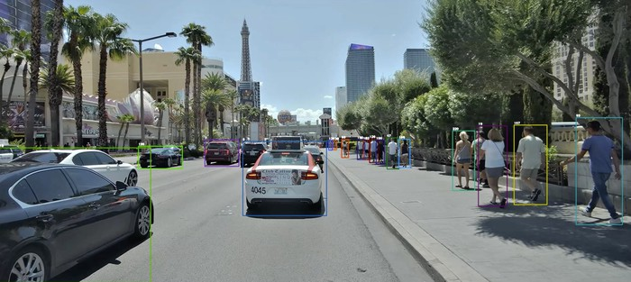 Camera view of vehicles and pedestrians being identified by a computer-vision chip