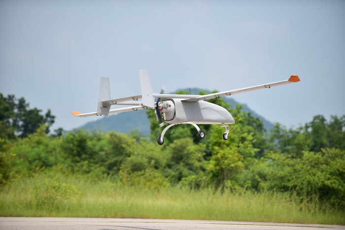 A military-style drone in flight