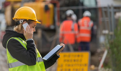 Female Engineer Using Tablet Device at Construction Site