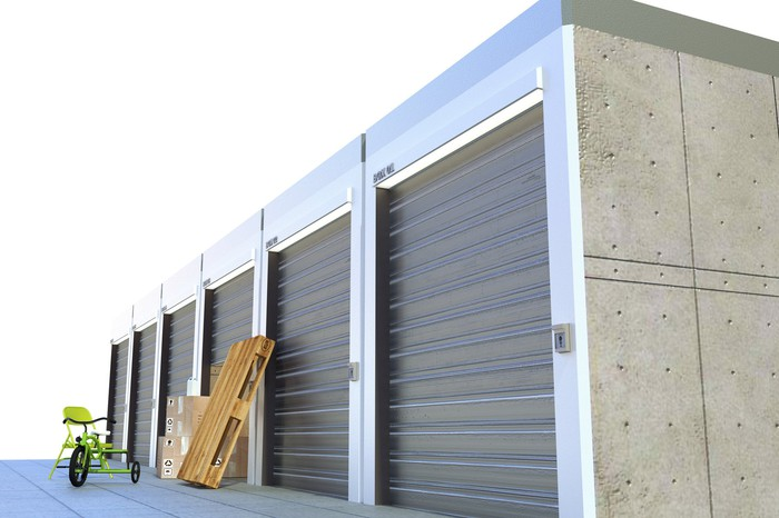 Free-standing outdoor storage unit with garage-style doors.