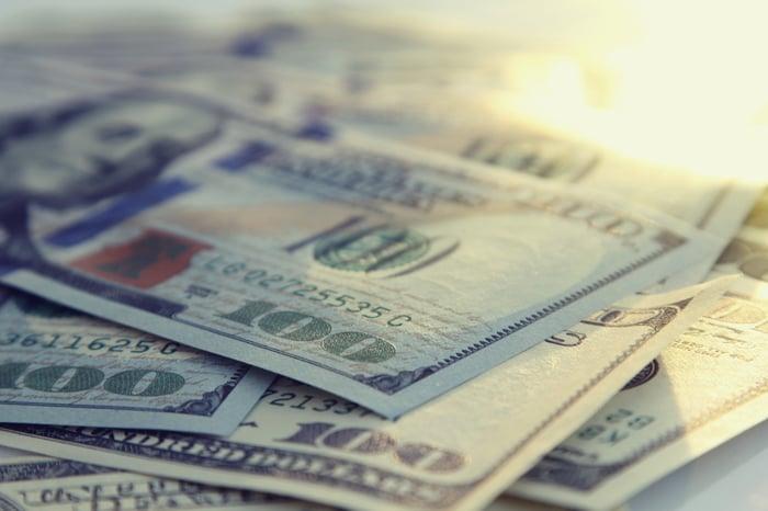A stack of $100 bills, seen close up