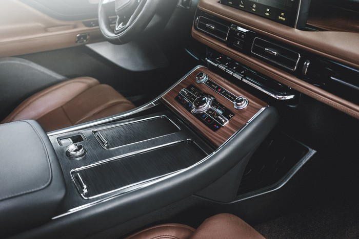 The dashboard and center console of a 2019 Lincoln Aviator, showing wood-and-leather trim with chrome accents.