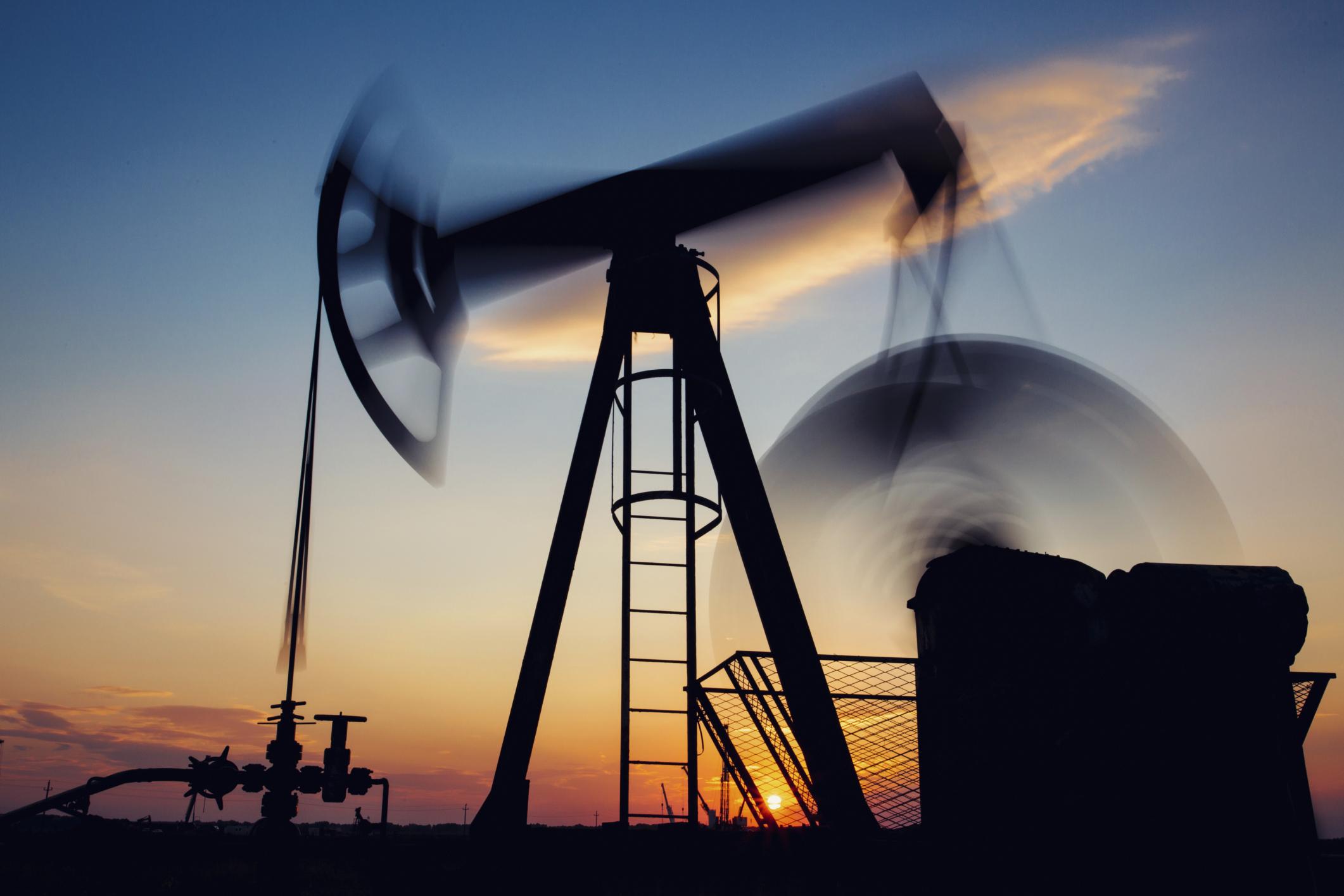 Oil pumpjack at sunrise.