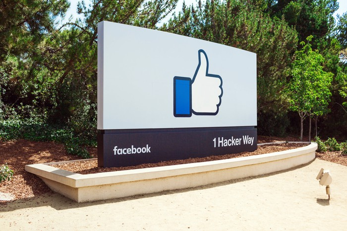 "Sign at Facebook's Menlo Park, California headquarters depicting a large ""Like"" thumbs-up icon."